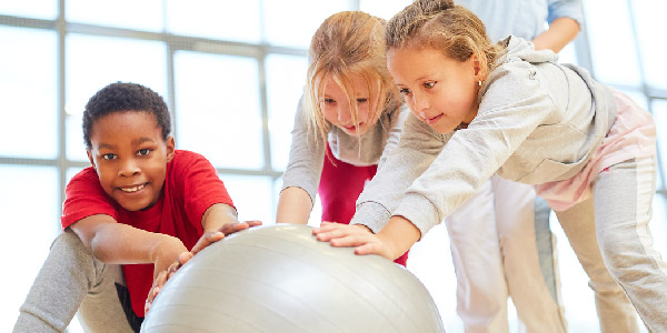 Kids playing with exercise ball